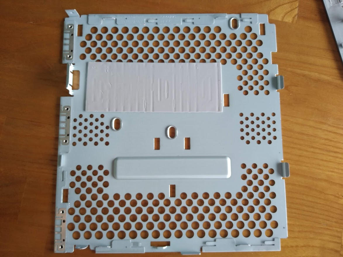 Thermal pad on the interior of the T610's side panel.